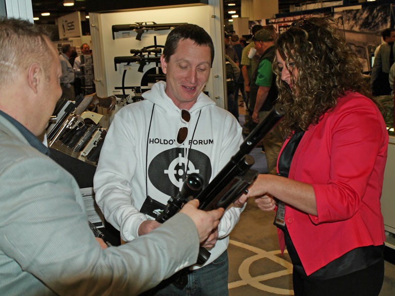 new airguns at SHOT Show Ted Bier reviews an Air Arms rifle at The Pyramid Air booth